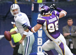 Brian Robison chases down Tony Romo