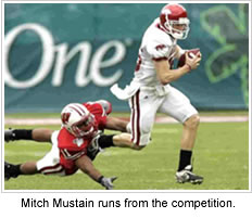 Mitch Mustain runs from the competition.