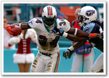 Ricky Williams runs over the Titans