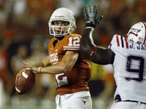 Colt McCoy looks to pass against FAU