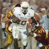 Vince Young runs over a USC defender
