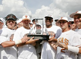 The Texas baseball team holds the Big 12 Tourney trophy. (TexasSports.com)