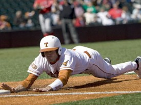 Connor Rowe slides back into the newly FieldTurfed first base.