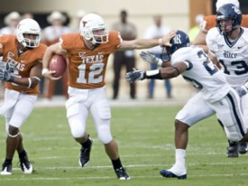 Colt McCoy bulldozes a Rice defender