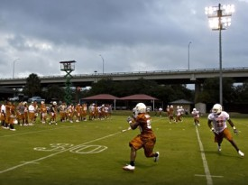 QB Colt McCoy passes to RB Fozzy Whittaker on the first day of practice. (Statesman.com)