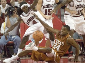 Without a true point guard, Justin Mason and the Horns have struggled this season.