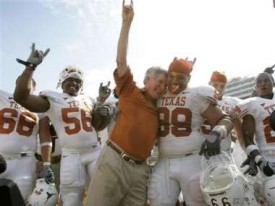 Mack Brown celebrates after beating OU