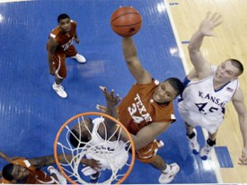 Dexter Pittman dunks against the KU defense. (AP)