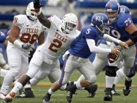 Sergio Kindle and the Texas defense will make Todd Reesing run for his life.