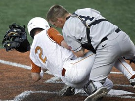 Travis Tucker attempts to slide into home against Army. (Statesman.com)