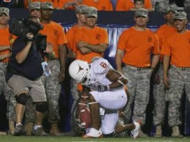 Quan Cosby kneeling after scoring a touchdown